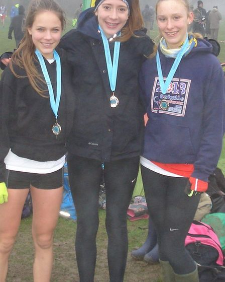 Hunts AC athletes Polly Smith, Ella Blake and Amy Chalmers who won the team silver medal in the Unde