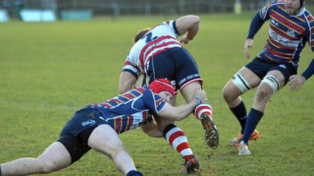 Max Wilkins puts in a tackle