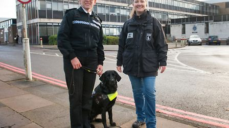 Herts assistant Chief Constable Michelle Dunn walks with Kelley Strachan, mobility instructor and Yo