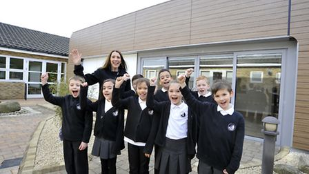 Pupils from Key Stage 2 show off the building and new uniform with headteacher Stephanie Baldwin. Pi