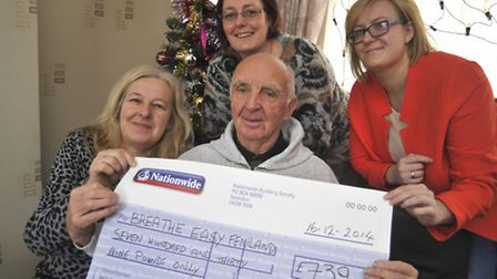 Breathe Easy committee member Cyril Judd, receives a cheque for £739 from (pictured from left) Susan