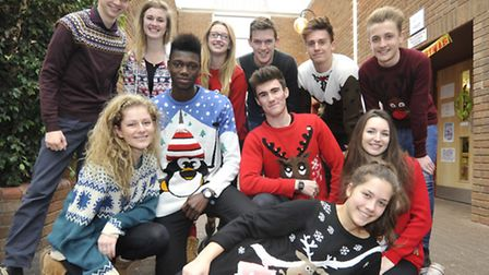Some of the sixth form students show off their Christmas jumpers.