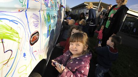 Clover, front, helps paint the VW Transporter. Picture: HELEN DRAKE.