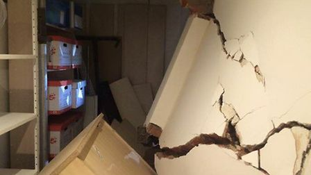 The family's home office was left in pieces after a rogue driver drove into it