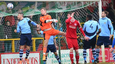 Lee Chappell and goalkeeper Tom Coulton can't stop Ollie Hawkins from scoring Hemel Hempstead's firs