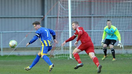 Huntingdon Town's Declan Rogers, left, is a wanted man. Picture: Steve Williams.