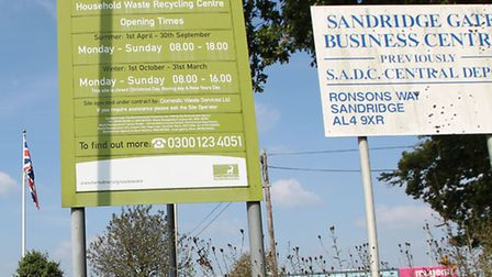 Local cllr Salih Gaygusuz stands outside the St Albans recycling centre where he was arrested when t