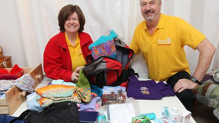 St Albans priory rotary club president Caroline Ellis and her husband Brian at home packing their ba