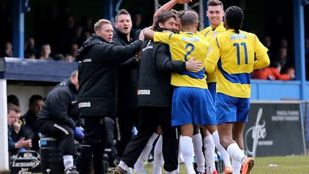 The players and managers celebrate the opening goal. Picture: Leigh Page