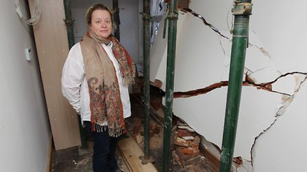 Jannine Oxley stands inside her house which was damaged by an unknown car around Christmas time