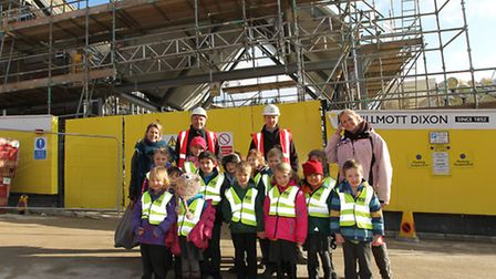 Willmott Dixon build managers Richard Ward and Peter Andrews with teachers and pupils of Harpenden f