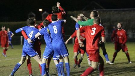 London Colney and Cockfosters contend a cross. Picture: James Whittamore