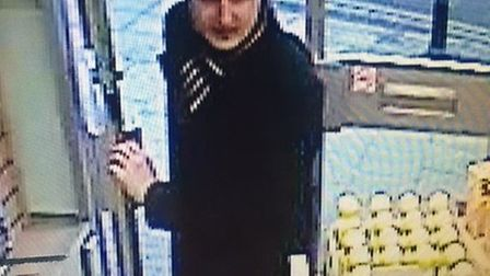 Do you recognise this man who may have witnessed a theft of a wallet at the post office in London Ro