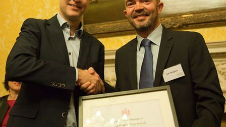 Ian Callaghan receiving his Mental Health Hero certificate from deputy prime minister Nick Clegg.