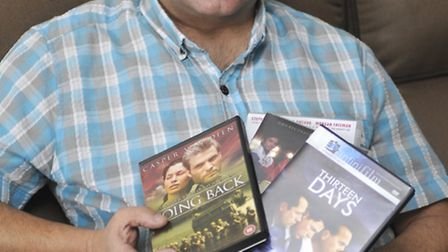 Andrew Sharpe with copies of some of the films he has starred in.