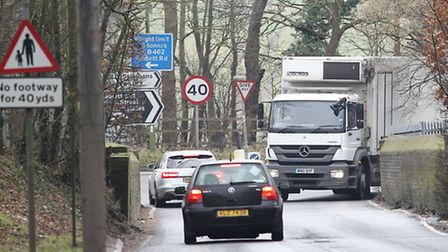 A lorry has to wait to let cars cross the bridge on Harper lane, leading to Watling Street