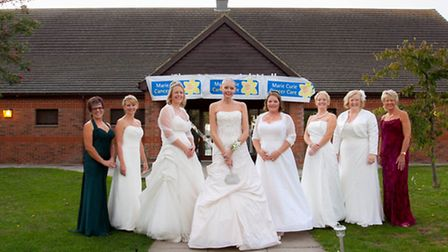 Claire Senior (centre) and guests at her Wedding Wishes ball in Alconbury.