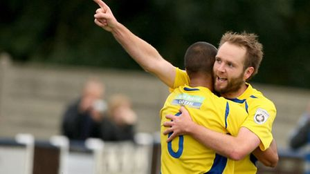 James Comley congratulates Lee Clarke on score the Saints' second of the afternoon. Picture: Leigh P