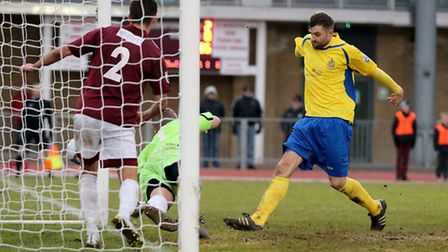 Darren Locke scores past the outstretched Tom Lovelock. Picture: Leigh Page