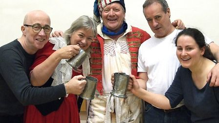 Les Miserables innkeepers Thenadier (Brian Perrett) and Madame Thenadier (Mary Chapman) with guests