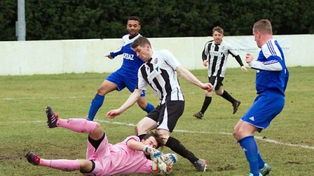 Two-goal striker Stuart Eason in action for St Ives Town in their 4-0 win over North Greenford on Fe