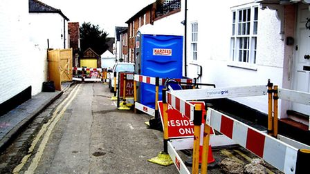 National Grid's gas mains upgrade works in Queen Street have caused parking mayhem for residents