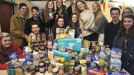 St Ivo School Sixth Form students, with their foodbank donations.