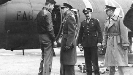 King George VI talks to an airman of the 301st Bomb Group during a visit to RAF Alconbury in 1942. T