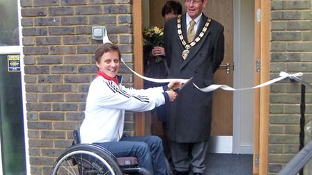 Emma Wiggs cutting the ribbon watched by Mayor of Hertsmere, Cllr Carey Keates.