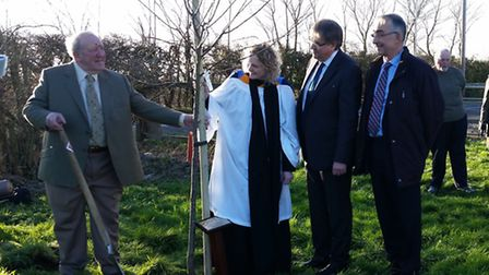 Councillor Mike Newman, left, at the surprise tree planting ceremony held in his honour.
