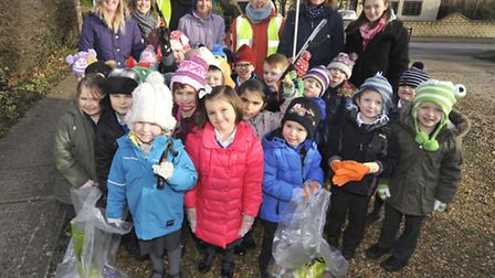 Pupils from Holywell Primary School, litter picking at Needingworth Park,