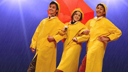 The cast getting into the Singin' in the Rain spirit.