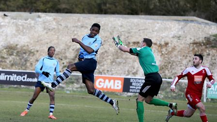 Omar Beckles heads the ball over the advancing Craig Ross to bring the Saints level. Picture: Leigh