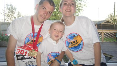 Lewis Gray, centre, with his dad, Alex, and mum, Emma.