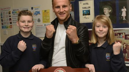 Boxer Tommy Martin at Longsands with pupils Jamie Houseago and Jessica Ashton.
