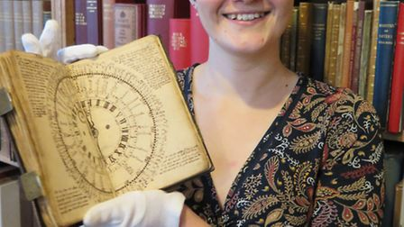 Museum curator Sarah Russell with the Pettis survey from 1728.