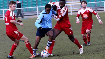 Jamal Lowe breaks past David Ijaha and Lee Hills. Picture: Leigh Page