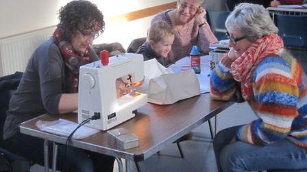 Jacky Racher working the sewing machine at the Royston Repair Cafe last week.