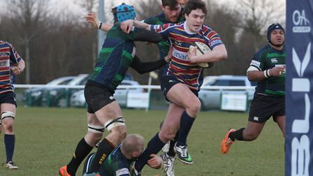 Dom Regan slips a couple of tackles as he drives for the line