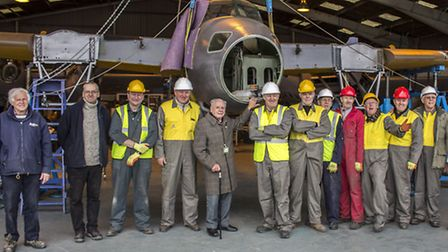 The team of volunteers who reunited the wings with the fuselage of the de Havilland Mosquito.