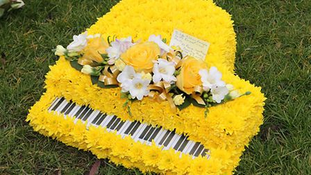 A floral tribute laid outside the church in Meldreth for Edward Mallen's funeral