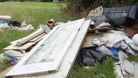 Piles of fly-tipping in the countryside