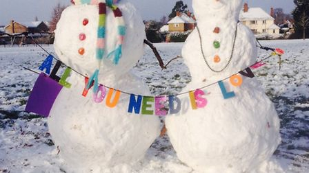 Mystery snowman builders have brought smiles by making this couple. Picture: Mark Brookbanks