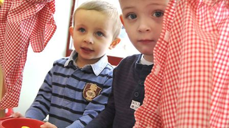 Buckden Pre-School Playgroup celebrate their good Ofsted, (l-r) Leo, and Kobi, in the cafe,