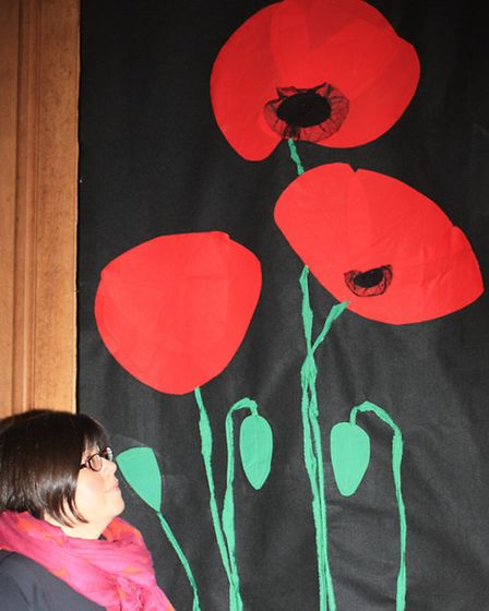 Rebecca Gatward with her Silent Night contribution, depicting the Christmas truce of the First World