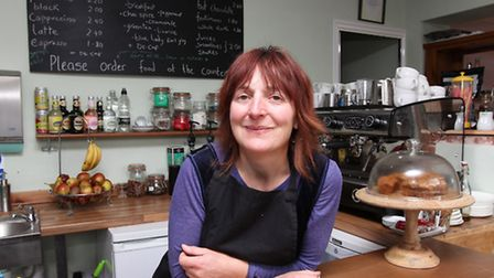 Owner of the The Green Kitchen Heather Foster behind her counter