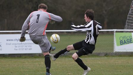 Aaron Clarke is beaten to the ball by the goalkeeper