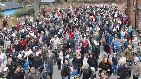 Families hop on the spot in an attempt to break the Guinness World Record to have the most amount of