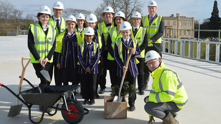 Kimbolton School pupils, staff and contractors on the roof of the new building.