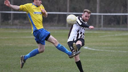 Jay Welsh plays the ball forward